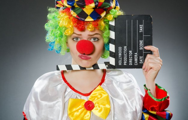 45408783 - clown with movie clapper in funny concept