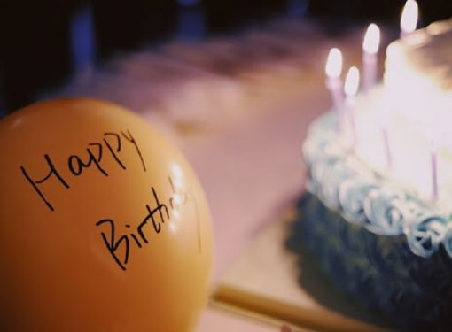 the words happy birthday written on a balloon, a blog pst on how to use a birthday name song maker
